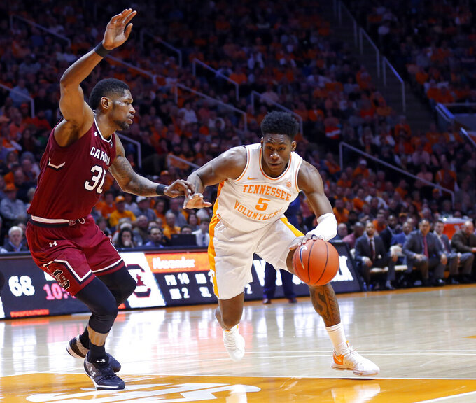 Tennessee guard Admiral Schofield (5) drives against South Carolina forward Chris Silva (30) during the second half of an NCAA college basketball game Wednesday, Feb. 13, 2019, in Knoxville, Tenn. Tennessee won 85-73. (AP photo/Wade Payne)