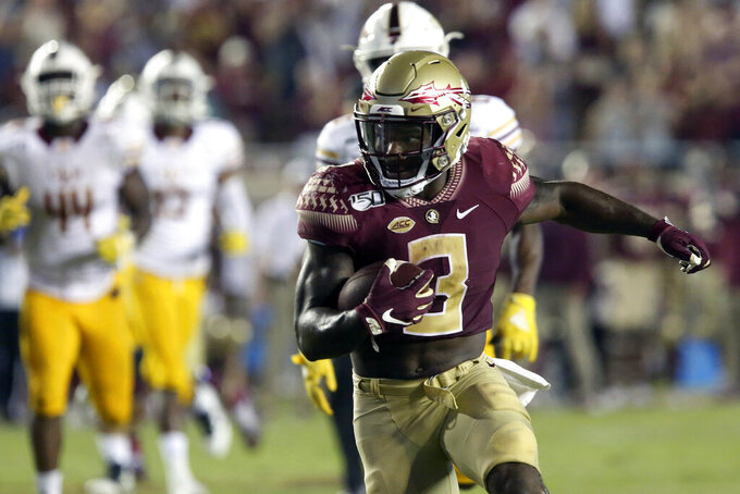 Florida State's Cam Akers breaks free of the Louisiana-Monroe's defense to score a touchdown in the fourth quarter of an NCAA college football game Saturday, Sept. 7, 2019, in Tallahassee Fla. (AP Photo/Steve Cannon)