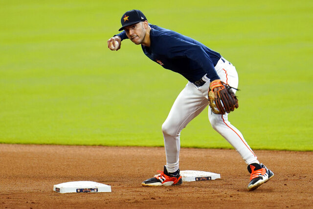 Houston Astros shortstop Carlos Correa runs through a drill during a baseball practice at Minute Maid Park, Sunday, July 5, 2020, in Houston. (AP Photo/David J. Phillip)
