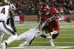 California cornerback Traveon Beck tackles Washington State running back James Williams (32) during the first half of an NCAA college football game in Pullman, Wash., Saturday, Nov. 3, 2018. (AP Photo/Young Kwak)