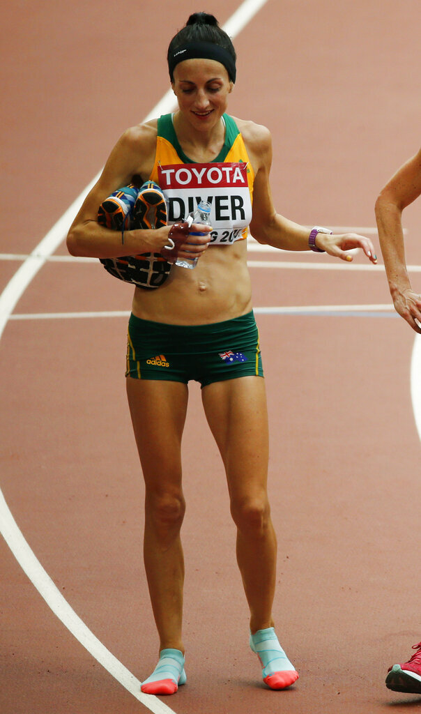 FILE - In this Aug. 30, 2015, file photo, Australia's Sinead Diver reacts after finishing the women's marathon at the World Athletics Championships at the Bird's Nest stadium in Beijing, China. Ireland-born Diver is set to become the oldest athlete to race for Australia in Olympic athletics competition after being among the six marathoners selected for the Tokyo Games.(AP Photo/Mark Schiefelbein, File)