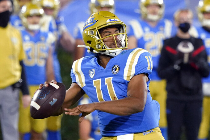 UCLA quarterback Chase Griffin looks for a receiver during the second half of the team's NCAA college football game against Arizona on Saturday, Nov. 28, 2020, in Pasadena, Calif. (AP Photo/Marcio Jose Sanchez)