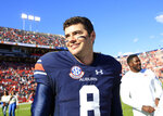 Auburn Tigers quarterback Jarrett Stidham (8) celebrates the victory against Texas A&M following an NCAA college football game, Saturday, Nov. 3, 2018, in Auburn, Ala. (AP Photo/Todd Kirkland)