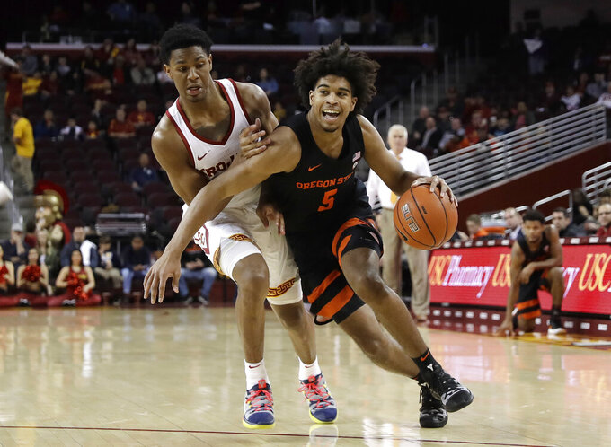 Oregon State 's Ethan Thompson, right, is defended by Southern California 's Elijah Weaver, left, during the first half of an NCAA college basketball game Saturday, Feb. 23, 2019, in Los Angeles. (AP Photo/Marcio Jose Sanchez)
