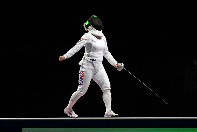 Kang Young Mi of South Korea celebrates winning a point as competes with Katrina Lehis of Estonia in the women's individual Epee team final competition at the 2020 Summer Olympics, Tuesday, July 27, 2021, in Chiba, Japan. (AP Photo/Hassan Ammar)