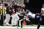 Atlanta Falcons quarterback AJ McCarron (5) runs against the Tennessee Titans during the first half of a preseason NFL football game, Friday, Aug. 13, 2021, in Atlanta. (AP Photo/John Bazemore)