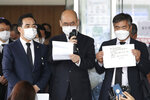 "Officials from the Seoul Metropolitan Government show a note, right, of deceased Seoul Mayor Park Won-soon at a hospital in Seoul, South Korea, Friday, July 10, 2020. The mayor left the note saying he felt ""sorry to all people"" before he was found dead early Friday, officials in the South Korean capital said as people began mourning the liberal legal activist seen as a potential presidential candidate. (Im Hwa-young/Yonhap via AP)"