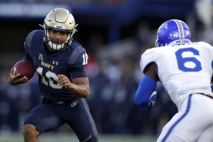 Navy quarterback Malcolm Perry, left, runs with the ball as Air Force defensive back Zane Lewis moves in for the hit during the second half of an NCAA college football game Saturday, Oct. 5, 2019, in Annapolis, Md. Navy won 34-25. (AP Photo/Julio Cortez)