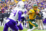 North Dakota State quarterback Trey Lance (5) runs the ball as James Madison safety D'Angelo Amos (24) pursues during the first half of the FCS championship NCAA college football game, Saturday, Jan. 11, 2020, in Frisco, Texas. (AP Photo/Sam Hodde)