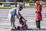 In this image provided by the U.S. Navy, NAVAL STATION ROTA, Spain (Aug. 28, 2021) a family of evacuees from Afghanistan play together at a temporary housing facility at Naval Station, Rota, Spain, on Saturday, Aug. 28, 2021. (Petty Officer 1st Class Nathan Carpenter/U.S. Navy via AP)