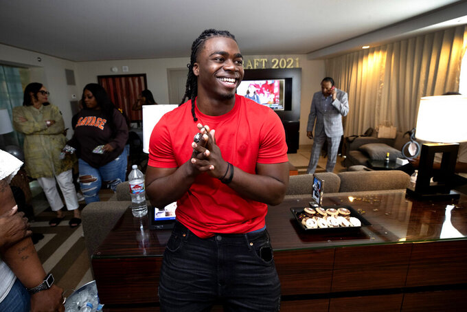 Oklahoma running back Rhamondre Stevenson smiles in a suite at the Aria Resort in Las Vegas, Saturday, May 1, 2021, after he was selected in the fourth round of the NFL football draft by the New England Patriots. (Steve Marcus/Las Vegas Sun via AP)