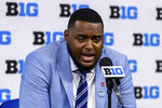 Illinois offensive tackle Vederian Lowe talks to reporters during an NCAA college football news conference at the Big Ten Conference media days, Thursday, July 22, 2021, at Lucas Oil Stadium in Indianapolis. (AP Photo/Doug McSchooler)