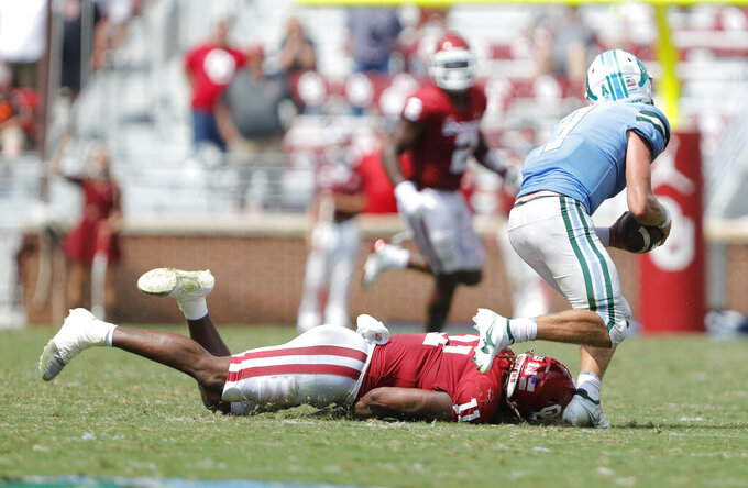 Tulane quarterback Michael Pratt (7) escapes a tackle from Oklahoma linebacker Nik Bonitto (11) during an NCAA college football game Saturday, Sept. 4, 2021, in Norman, Okla. (AP Photo/Alonzo Adams)
