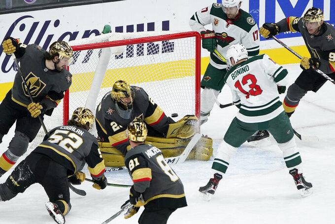 Minnesota Wild center Nick Bonino (13) scores on Vegas Golden Knights goaltender Marc-Andre Fleury (29) during the second period of an NHL hockey game Monday, March 1, 2021, in Las Vegas. (AP Photo/John Locher)
