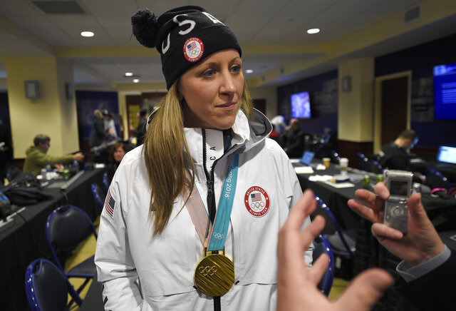 FILE - In this March 3, 2018, file photo, Meghan Duggan, of the gold medal-winning U.S. women's Olympic hockey team, listens to a question from the media before an outdoor NHL hockey game between the Washington Capitals and the Toronto Maple Leafs in Annapolis, Md. U.S. women's hockey captain Duggan announced her retirement Tuesday, Oct. 13, 2020, after a career in which she won the 2018 Olympic gold medal and seven world championship golds. (AP Photo/Nick Wass, File)