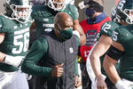 Michigan State head coach Mel Tucker runs onto the field before the first half of an NCAA college football game against Indiana, Saturday, Nov. 14, 2020, in East Lansing, Mich. (AP Photo/Carlos Osorio)