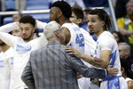 North Carolina head coach Roy Williams speaks with guard Cole Anthony (2) during the first half of an NCAA college basketball game against Boston College in Chapel Hill, N.C., Saturday, Feb. 1, 2020. (AP Photo/Gerry Broome)