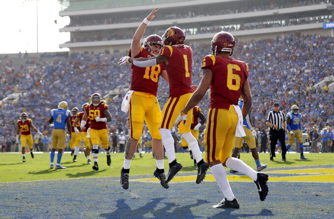 Southern California wide receiver Velus Jones Jr. (1) celebrates his touchdown reception with quarterback JT Daniels (18) during the first half of an NCAA college football game against UCLA, Saturday, Nov. 17, 2018, in Pasadena, Calif. (AP Photo/Marcio Jose Sanchez)
