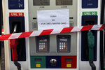 A gas station pump is closed during a protest against tight supply of dollars from the central bank in Beirut, Lebanon, Thursday, Nov. 28, 2019. Scores of Lebanese businesses have closed in recent months and thousands of employees were either laid off or are getting half their salaries amid the crisis. Local banks have imposed capital controls worsening the economic conditions amid a liquidity crisis and shortage in U.S. dollars.(AP Photo/Bilal Hussein)