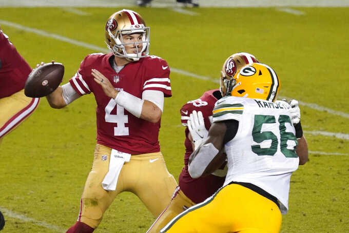 San Francisco 49ers quarterback Nick Mullens (4) passes against the Green Bay Packers during the second half of an NFL football game in Santa Clara, Calif., Thursday, Nov. 5, 2020. (AP Photo/Tony Avelar)