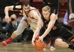 Stanford center Josh Sharma, left, reaches for the ball next to Utah guard Parker Van Dyke during the first half of an NCAA college basketball game in Stanford, Calif., Thursday, Jan. 24, 2019. (AP Photo/Jeff Chiu)