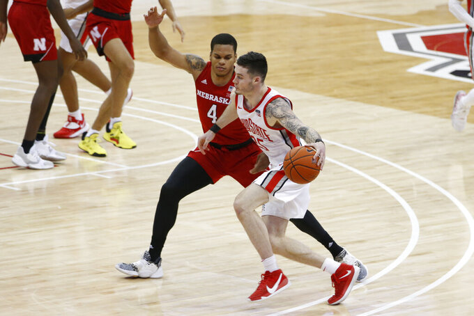Ohio State's Kyle Young, right, drives against Nebraska's Shamiel Stevenson during the second half of an NCAA college basketball game Wednesday, Dec. 30, 2020, in Columbus, Ohio. (AP Photo/Jay LaPrete)