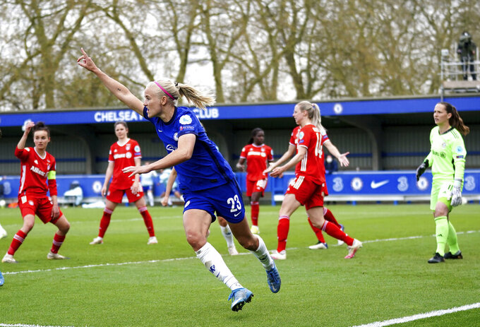 Chelsea's Pernille Harder celebrates scoring their side's third goal of the game during their UEFA Women's Champions League semi final, second leg soccer match against Bayern Munich at Kingsmeadow in London, Sunday May 2, 2021. (John Walton/PA via AP)