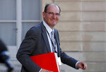 FILE - In this May 19, 2020 file photo, French government coordinator for the end of lockdown Jean Castex leaves after a videoconference with the French President and French mayors at the Elysee Palace in Paris. French President Emmanuel Macron has named Jean Castex, who coordinated France's virus reopening strategy, as new prime minister on Friday July 3, 2020. Emmanuel Macron is reshuffling the government to focus on reviving the economy after months of lockdown. (Gonzalo Fuentes/Pool via AP, File)