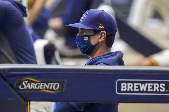 Milwaukee Brewers manager Craig Counsell watches during the first inning of a baseball game against the Minnesota Twins Tuesday, Aug. 11, 2020, in Milwaukee. (AP Photo/Morry Gash)