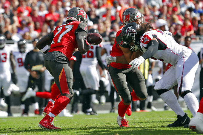 Tampa Bay Buccaneers running back Ronald Jones II (27) fumbles the football on a run against the Atlanta Falcons during the first half of an NFL football game Sunday, Dec. 29, 2019, in Tampa, Fla. Atlanta recovered the fumble. (AP Photo/Mark LoMoglio)