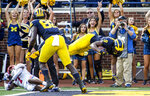 Michigan wide receiver Donovan Peoples-Jones (9) leaps into the end zone for a touchdown in the second quarter of an NCAA college football game against SMU in Ann Arbor, Mich., Saturday, Sept. 15, 2018. (AP Photo/Tony Ding)