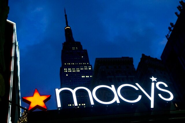 FILE - In this Nov. 21, 2013, file photo, with the Empire State building in the background, the Macy's logo is illuminated on the front of the department store in New York. Macy's Inc. (M) on Thursday, Nov. 21, 2019, reported fiscal third-quarter net income of $2 million. The Cincinnati-based company said it had net income of 1 cent per share. Earnings, adjusted for one-time gains and costs, came to 7 cents per share. (AP Photo/Mark Lennihan, File)