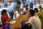 Opposition leader David Smolansky talks with Venezuelans eating at the