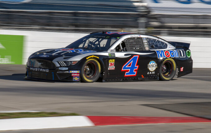 Kevin Harvick races for position during qualifying for the NASCAR Monster Energy Cup Series race at Martinsville Speedway in Martinsville, Va., Saturday, March 23, 2019. (AP Photo/Matt Bell)