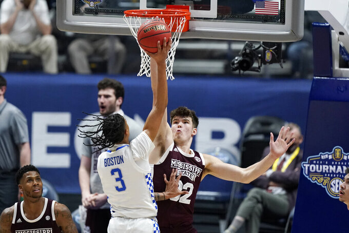 Kentucky's Brandon Boston Jr. (3) shoots against Mississippi State's Quinten Post (32) in the first half of an NCAA college basketball game in the Southeastern Conference Tournament Thursday, March 11, 2021, in Nashville, Tenn. (AP Photo/Mark Humphrey)