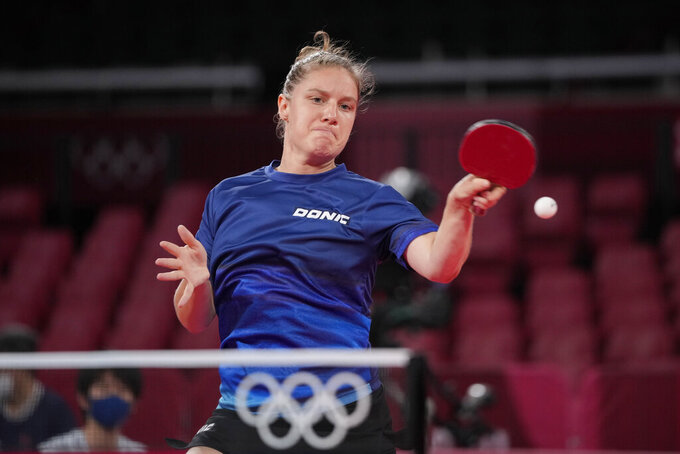 Switzerland's Rachel Moret competes during the table tennis women's singles second round match against Georgina Pota of Hungary at the 2020 Summer Olympics, Sunday, July 25, 2021, in Tokyo. (AP Photo/Kin Cheung)