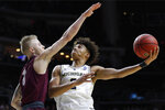 Michigan guard Jordan Poole shoots over Montana guard Timmy Falls, left, during a first round men's college basketball game in the NCAA Tournament, Thursday, March 21, 2019, in Des Moines, Iowa. (AP Photo/Charlie Neibergall)