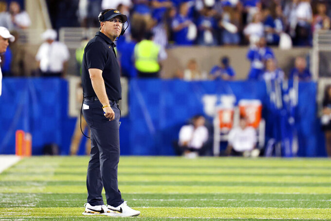 Missouri head coach Eliah Drinkwitz looks up at the video board during the first half of an NCAA college football game against Kentucky in Lexington, Ky., Saturday, Sept. 11, 2021. (AP Photo/Michael Clubb)