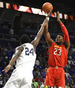 Maryland forward Bruno Fernando (23) takes a shot over Penn State forward Mike Watkins (24) during the first half of an NCAA college basketball game Wednesday, Feb. 27, 2019, in State College, Pa. (AP Photo/John Beale)