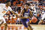 TCU guard R.J. Nembhard (22) dribbles the ball through contact during an NCAA college basketball game Wednesday, Feb. 5, 2020, in Stillwater, Okla. (Devin Lawrence Wilber/Tulsa World via AP)
