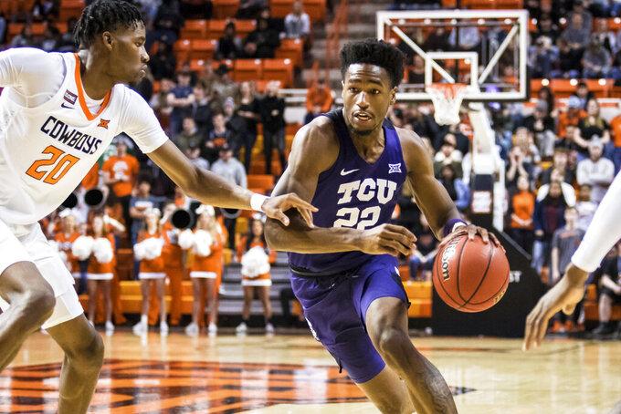 TCU guard R.J. Nembhard (22) dribbles the ball through contact during an NCAA college basketball game Wednesday, Feb. 5, 2020, in Stillwater, Okla. (Devin Lawrence Wilber/Tulsa World via AP)