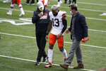 FILE - In this Oct. 25, 2020, file photo, Cleveland Browns wide receiver Odell Beckham Jr. heads off the field in the first half of the team's NFL football game against the Cincinnati Bengals in Cincinnati. Cleveland has a chance to reach the playoffs for the first time since 2002, and could do it without one of the league's most dynamic receivers. Beckham played in only seven games before a torn ACL put him on the sideline for the rest of the season. (AP Photo/Michael Conroy, File)