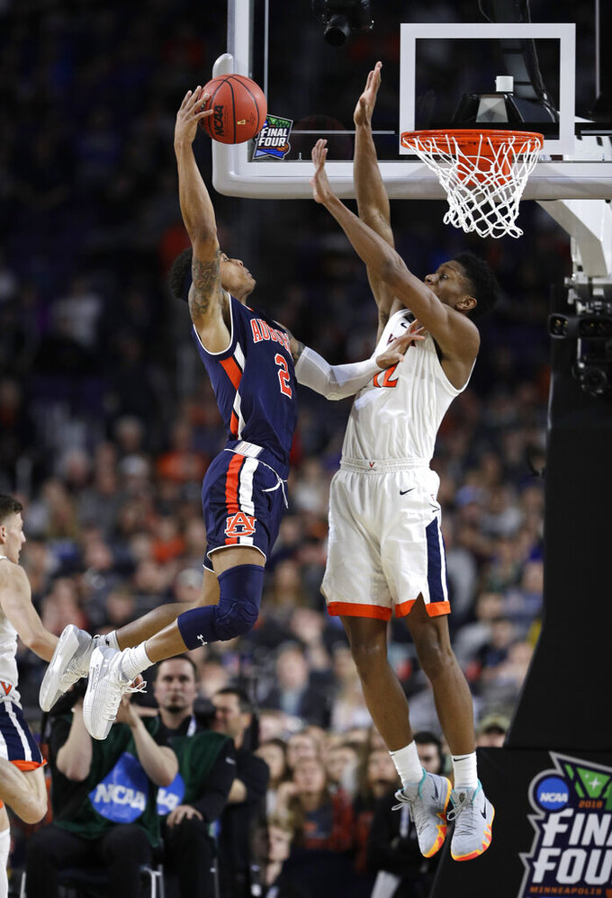 Auburn guard Bryce Brown, left, shoots over Virginia guard De'Andre Hunter during the second half in the semifinals of the Final Four NCAA college basketball tournament, Saturday, April 6, 2019, in Minneapolis. (AP Photo/David J. Phillip)