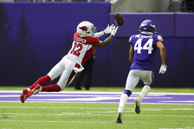 Arizona Cardinals wide receiver Pharoh Cooper (12) tries to make a reception in front of Minnesota Vikings cornerback Nate Meadors (44) during the second half of an NFL preseason football game, Saturday, Aug. 24, 2019, in Minneapolis. The pass was incomplete. (AP Photo/Jim Mone)