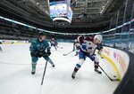 Colorado Avalanche center Carl Soderberg (34) moves the puck past San Jose Sharks defenseman Nicolas Meloche (53) during the second period of an NHL hockey game in San Jose, Calif., on Wednesday, May 5, 2021. (AP Photo/Tony Avelar)