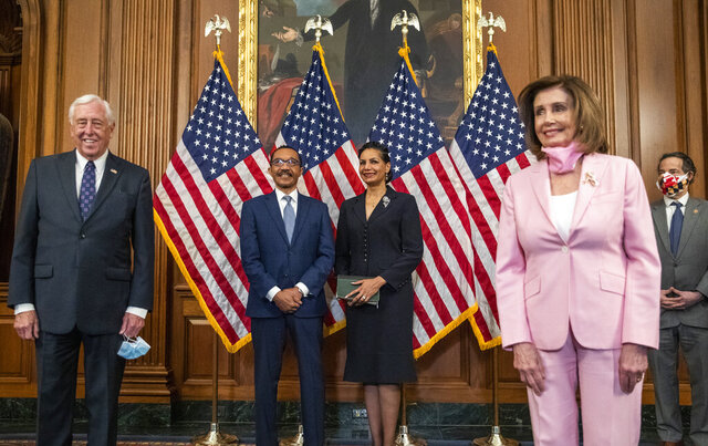 Rep. Kweisi Mfume, D-Md., with his wife Tiffany Mfume, back center, is joined by House Majority Leader Steny Hoyer of Md., left, following a ceremonial swearing-in ceremony conducted by House Speaker Nancy Pelosi of Calif., at the U.S. Capitol, Tuesday, May 5, 2020, in Washington. Baltimore Democrat Kweisi Mfume was sworn-in as Maryland's newest congressman succeeding the late Elijah Cummings. (AP Photo/Manuel Balce Ceneta)