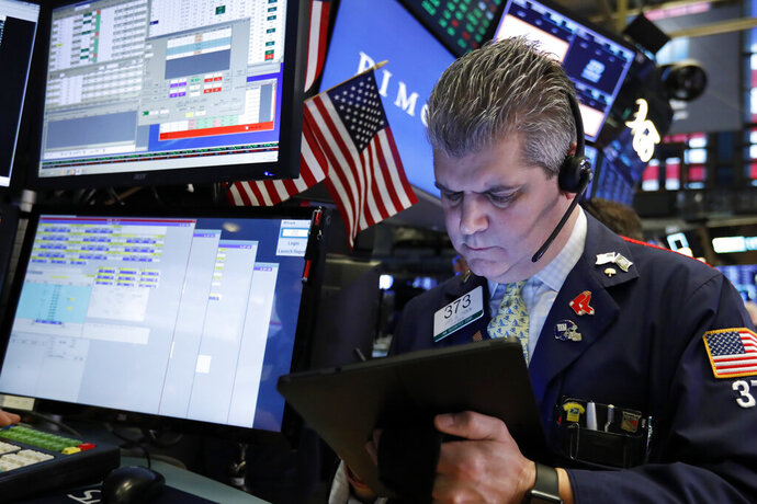 FILE- In this Feb. 15, 2019, file photo trader John Panin works on the floor of the New York Stock Exchange. The U.S. stock market opens at 9:30 a.m. EST on Thursday, Feb. 21. (AP Photo/Richard Drew, File)