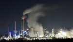 A Uniper coal-fired power plant and a BP oil refinery and chemical plant are at work in Gelsenkirchen, Germany, on Wednesday evening, Dec. 4, 2019. The UN Climate Change Conference COP 25 takes place in Madrid until Dec. 13, 2019, under the Presidency of the Government of Chile with logistical support from the Government of Spain. (AP Photo/Martin Meissner)