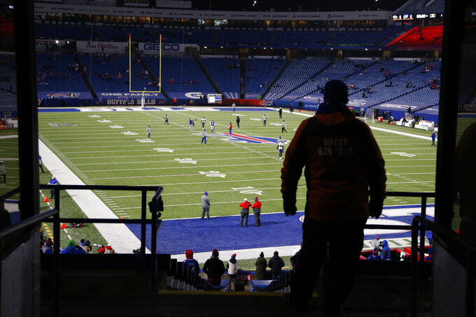 A fan at Bills Stadium watches teams warm up before an NFL divisional round football game between the Buffalo Bills and the Baltimore RavensSaturday, Jan. 16, 2021, in Orchard Park, N.Y. (AP Photo/Jeffrey T. Barnes)