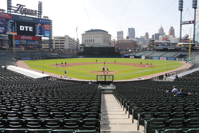 """FILE - In this Friday, July 10, 2020, file photo, the Detroit Tigers play an intrasquad baseball game, in Detroit. Michigan appears poised to amend a 1,000-patron limit so more Detroit Tigers fans can attend home games on Opening Day and after. Gov. Gretchen Whitmer's office said Monday, March 15, 2021, the state health department has had talks with the team """"to find a safe path forward to expand capacity limits at the stadium."""" (AP Photo/Carlos Osorio, File)"""